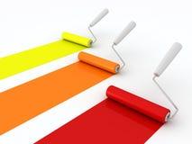Rolos de pintura com pintura no fundo branco Imagem de Stock