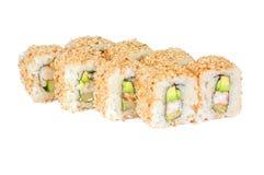 Rolos de sushi com abacate e camarão do sésamo Foto de Stock