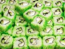 Rolos de sushi com peixes fumados, avacado e caviar foto de stock