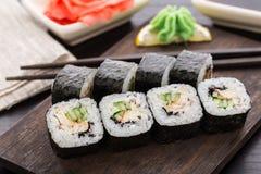 Rolos de sushi com a semente da enguia, do pepino e de sésamo Foto de Stock Royalty Free
