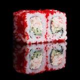 Rolos de sushi com varas e pepino do caranguejo Imagens de Stock Royalty Free