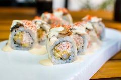 Rolos de sushi da enguia do mar em uma placa Imagem de Stock Royalty Free