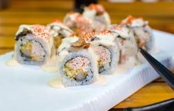 Rolos de sushi da enguia do mar em uma placa Imagens de Stock Royalty Free