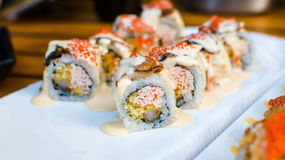 Rolos de sushi da enguia do mar em uma placa Fotos de Stock Royalty Free