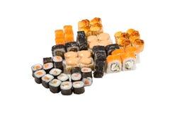 Rolos do japonês isolados em um branco Fotos de Stock