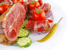 Rolos e pedaço de carne no branco Fotografia de Stock Royalty Free