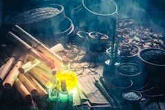 Rolos velhos e receita no laboratório mágico da cozinha imagens de stock royalty free