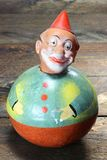 Roly-poly doll. Antique roly-poly doll on wooden background Stock Photography