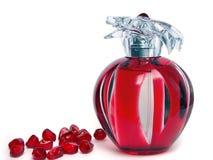 Romã e perfume Fotos de Stock Royalty Free
