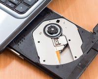 ROM do CD no portátil Imagem de Stock