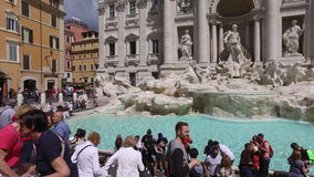 Roma city and Trevi fountain. Rome, may 24, 2016 : Tourists People Crowd Visit Iconic Baroque Trevi Fountain Fontana Rome Italy stock footage