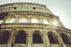 Roma, Colosseo with sun flare Stock Images