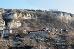 Roma hovels under the sign of Balchik town stock images