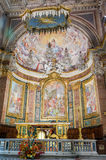 ROMA, ITALY - OCTOBER 2015:  Golden altar with icons, statues, crosses and images of saints in the church of San Giovanni e Paolo Stock Image