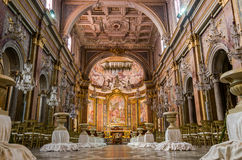 ROMA, ITALY - OCTOBER 2015:  Golden altar with icons, statues, crosses and images of saints in the church of San Giovanni e Paolo Stock Photo