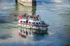 Roma, Italy - October 2015: An old retired grandparents tourists stroll riding on a boat tour on the River Tiber in Rome, Italy Royalty Free Stock Photos