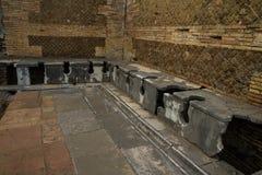 Roma latrines Ostia Antica Italy Royalty Free Stock Photo