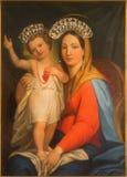 Roma - Madonna di verniciatura sull'altare laterale del dei barrocco Santi Ambrogio e Carlo al Corso della basilica della chiesa Fotografia Stock Libera da Diritti