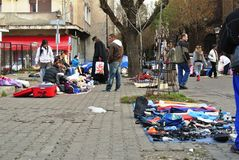Roma people selling goods in the street Stock Image