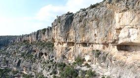 Roma Reliefs Adamkayalar. Aeriel view of Adamkayalar Roma Reliefs on the rocks in Mersin, Turkey stock footage