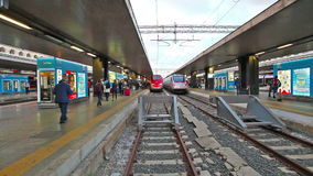 Roma Termini station train. Rome, Italy - May 12, 2016: High speed train Trenitalia Frecciarossa AV coming to stop at Roma Termini railway station stock footage