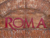 Roma Text bricks wall. Roma Text on bricks wall royalty free stock images