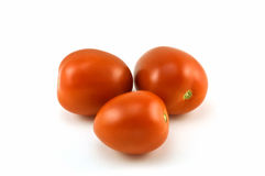 Roma tomatoes. Luscious ripe Roma tomatoes isolated on white background royalty free stock photography