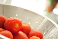 Roma Tomatoes in Colander with Water Drops Royalty Free Stock Photo