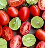 Roma Tomatoes and Key Limes in Cluster Royalty Free Stock Photo