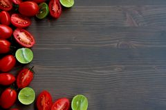 Roma Tomatoes and Key Limes on Wood Background Stock Photography