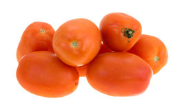 Roma tomatoes. Several roma variety tomatoes isolated on a white background royalty free stock images
