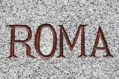 Roma Word Carved dans la pierre Photographie stock