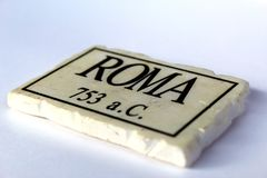 Roma writing on a marble tile with year of city establishment. Seen in diagonal perspective stock photography