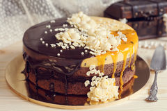 Romaantic cake with chocolate glaze, cream flowers and  mango pa Royalty Free Stock Image