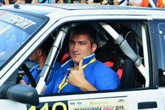 Romain Desire Marc Gilles driver shows thumb-up before the rally. CLUJ-NAPOCA, ROMANIA - JULY 21, 2016: Race car driver Romain Desire Marc Gilles shows thumb-up Royalty Free Stock Photos