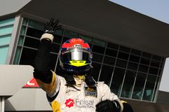 Romain Grosjean. DUBAI, UAE - APRIL 11-12 2008: GP2 Asia driver Romain Grosjean, after winning the 1st race of this 5th round,  at Dubai Autodrome Stock Image