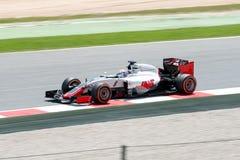 Romain Grosjean conduit la voiture d'équipe de Haas F1 sur la voie pour le Formule 1 espagnol Grand prix chez Circuit de Cataluny Images stock