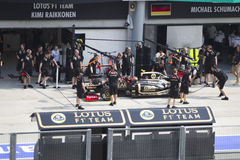 Romain Grosjean does a trial pit stop. French Romain Grosjean of Team Lotus does a trial pit during Friday practice at Petronas Formula 1 Grand Prix March 23 Royalty Free Stock Image