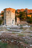 Roman Agora. Remains of the Roman Agora, Tower of Winds and Acropolis in Athens, Greece Stock Photo