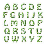 Grass and flowers alphabet set for children. Roman alphabet set for children with relief green letters covered with white five petaled flowers Royalty Free Stock Photo