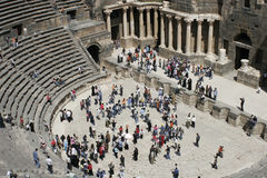 Roman amphitheater, Bosra, Syria, Middle East. Syrians dancing in Roman amphitheater, Bosra, Syria, Middle East Royalty Free Stock Photo