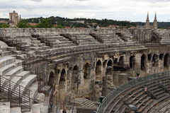 Roman Amphitheater, Nîmes, France. The Arena of Nîmes, a Roman amphitheatre enclosing an elliptical central space 133 m long by 101 m wide, is situated in Stock Photos