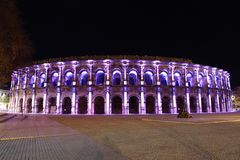 Roman Amphitheater in Nimes France illuminated at night stock images