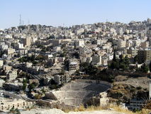 Roman Amphitheatre in Amman, Jordan. Amidst dense neighbourhood Royalty Free Stock Image