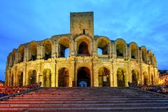 Roman amphitheatre in Arles, France. Illuminated at late evening Royalty Free Stock Image