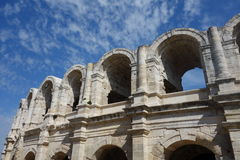 Roman Amphitheatre. With blue sky behind at Arles in Provence, South France Stock Photography