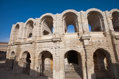 Roman amphitheatre (circa 90 AD). Arles, France. Exterior arcades of Roman amphitheatre (circa 90 AD) in Arles. National Heritage Site of France (monument Royalty Free Stock Image