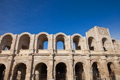 Roman amphitheatre (circa 90 AD). Arles, France. Exterior arcades of Roman amphitheatre (circa 90 AD) in Arles. National Heritage Site of France (monument Royalty Free Stock Images