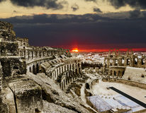 Roman amphitheatre in the city of El JEM in Tunisia amid colorfull sunset stock image