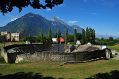 Roman amphitheatre converted to cinema. A roman ampitheatre converted to an open air cinema in Martigny, Switzerland. the large white screen with supporting Royalty Free Stock Photos